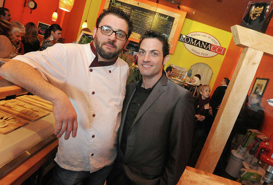 Graziano and Maurizio Ricci, owners of Romanacci, Italian Eatery and & Treats at the grand opening in the Country Mall Shopping Center on Westport avenue in Norwalk. hour photo/Matthew Vinci