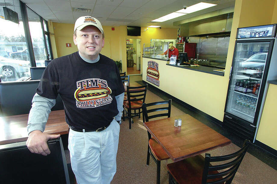 Hour Photo/ Alex von Kleydorff Tim Allabashi, owner of Tim's Philly Steaks, in his Westport Avenue location. / 2012 The Hour Newspapers