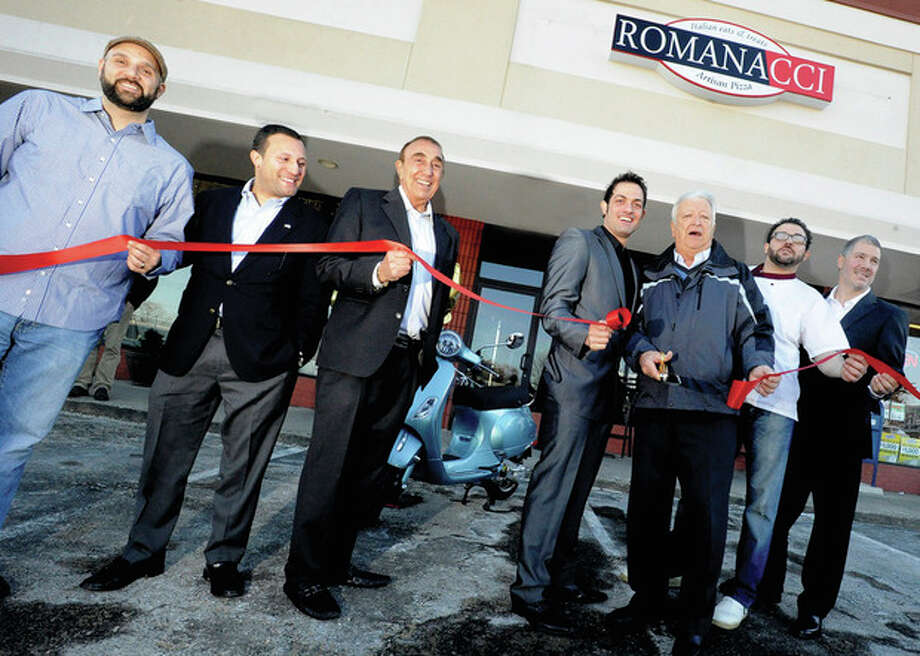 Grand opening of Romanacci in Norwalk, From left, John Discala with M.F. Discala & Company Inc., Warren Pena, Norwalk Common Council, Michael Discala, M.F. Discala & Company Inc, Maurizio Ricci, co-owner, Norwalk Mayor Richard Moccia, Graziano Ricci co-owner and Joe Breault, Vice President, Property Management and Construction, M.F. DiScala & Company Inc. hour photo/Matthew Vinci