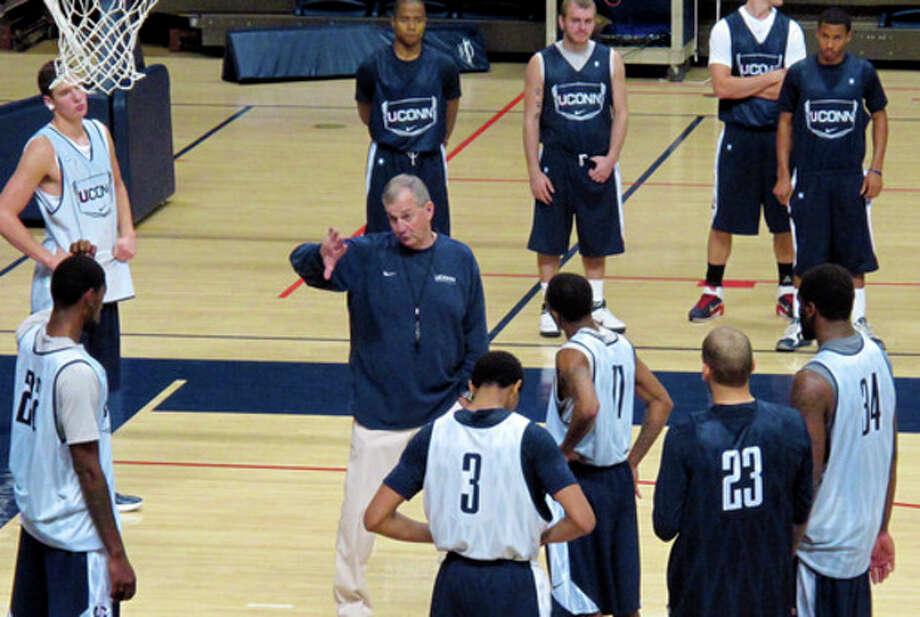 Connecticut head coach Jim Calhoun, center, runs his team through an NCAA college basketball practice at Gampel Pavilion in Storrs, Conn., on Friday, Oct. 28, 1011. Changes in NCAA rules adopted Thursday would keep defending national champion Connecticut from participating in the 2013 NCAA men's basketball tournament, as the school's academic performance of student athletes would fall below the Academic Progress Rate requirement. (AP Photo/Pat Eaton-Robb) / AP