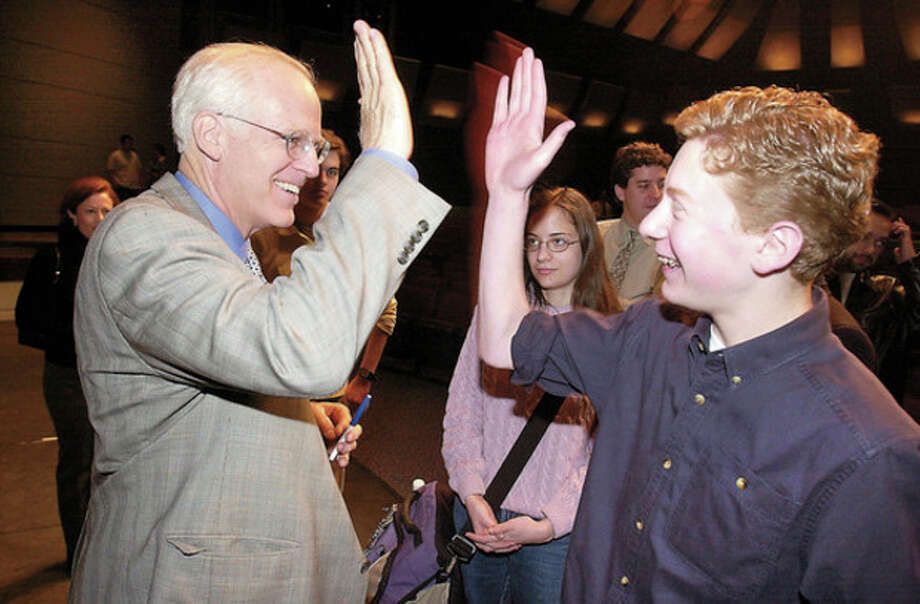 state rep chris shays gives whs junior Daniel Prial a high five after his talk. the student had gone to washington dc to lobby for campaign finance reform last year and now thats its a reality he gets a high five congratulation from shays