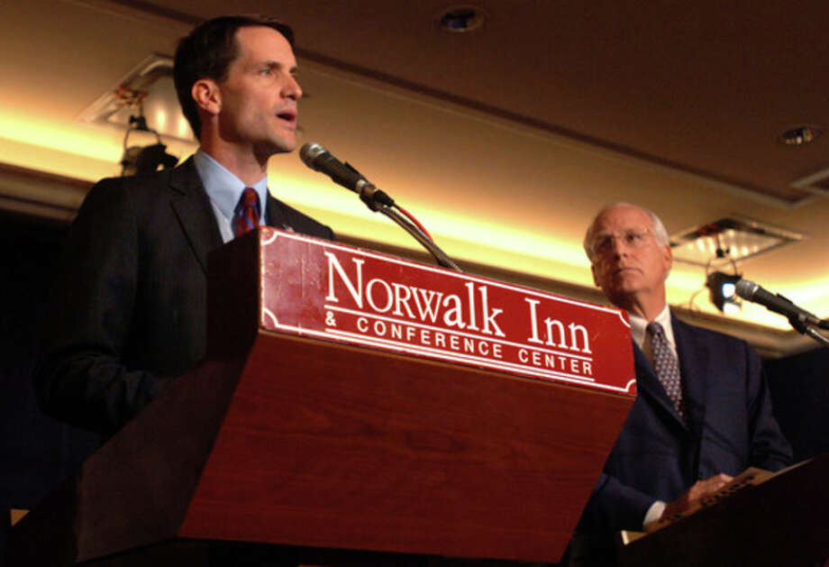 Congressman Chris Shays listens as his Democratic opponent Jim Himes answers a question during their debate Tuesday afternoon at the Norwalk Inn.