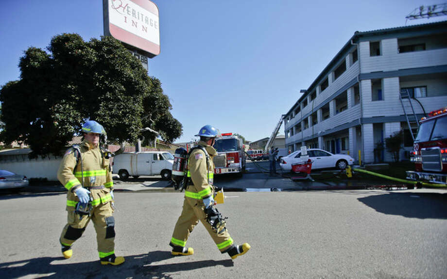 Firefightersrespond to the Heritage Hotel after an explosion on Wednesday, Jan. 30, 2013, in San Diego. The cause of the explosion is under investigation. Three people were injured in the explosion at the hotel near SeaWorld San Diego and investigators were trying to determine whether there was a drug lab inside, authorities said. Three people were taken to a hospital to be treated for burns and one was in serious condition, said San Diego Fire-Rescue Department spokesman Maurice Luque. (AP Photo/Lenny Ignelzi) / AP