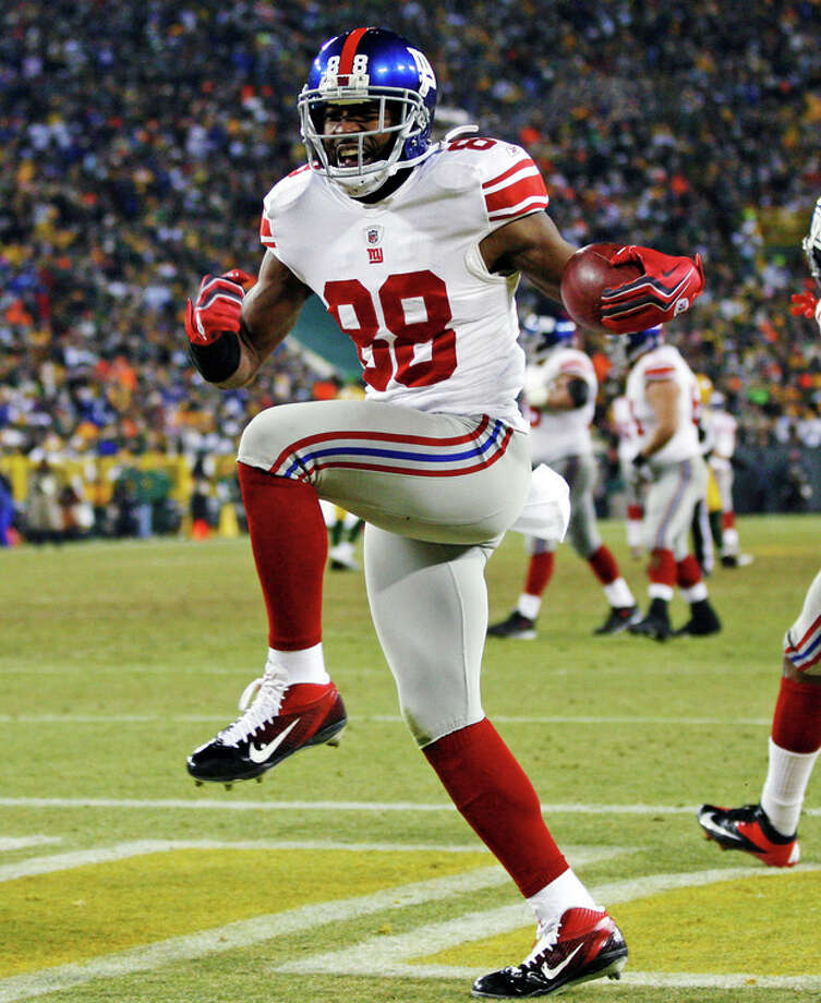 New York Giants wide receiver Hakeem Nicks (88) celebrates after catching a 37-yard touchdown pass during the first the first half of an NFL divisional playoff football game against the Green Bay Packers Sunday, Jan. 15, 2012, in Green Bay, Wis. The Giants won 37-20. (AP Photo/Mike Roemer) / Copyright 2012 The Associated Press. All rights reserved. This material may not be published, broadcast, rewritten or redistributed.