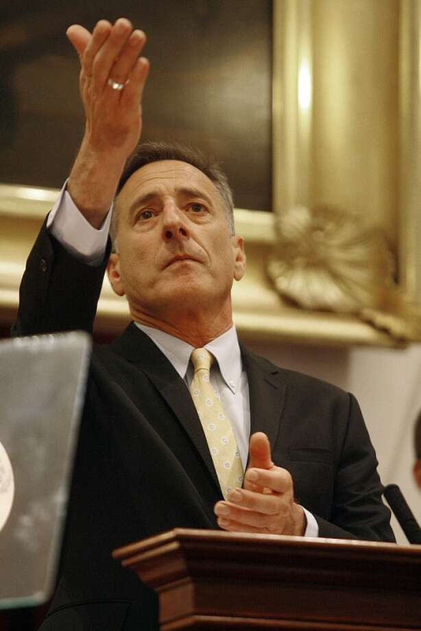 Gov. Peter Shumlin gestures during his State of the State address Thursday, Jan. 5, 2012 in Montpelier, Vt. Shumlin talked up recent success in job growth, thanked those involved in recovery from Tropical Storm Irene and vowed to avoid any increases in broad-based taxes like those on income and sales as the state seeks to close a $46 million budget gap. (AP Photo/Toby Talbot)