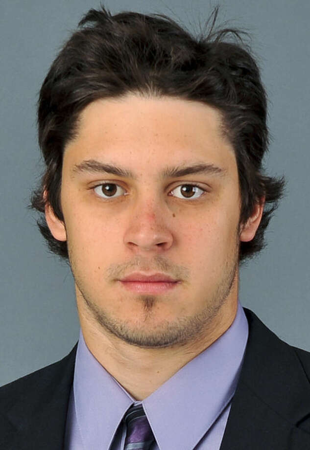In an Aug. 29, 2010, photo provided by Quinnipiac University, Quinnipiac goalie Eric Hartzell poses for a photo in Hamden. Conn. The Bobcats are 18-3-3, unbeaten in their last 17 games and ranked second in the nation on Jan. 29. Hartzell leads the nation with a goals-against average of 1.46. (AP Photo/Quinnipiac University, John Hassett)