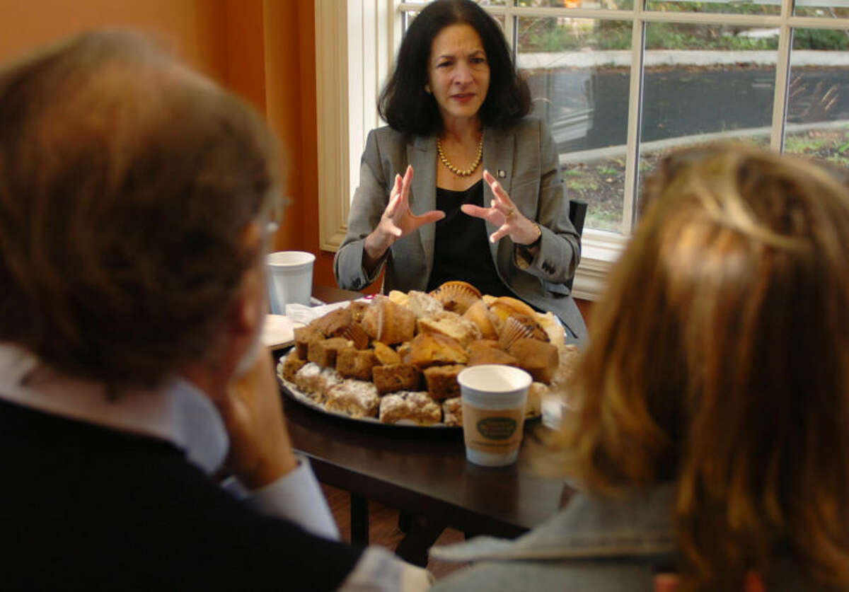 State Representative Gail Lavielle (R-143) holds a meeting with local business owners at Steve's Bagels in Wilton Tuesday morning ahead of the General Assembly's special session on jobs. Hour photo / Erik Trautmann