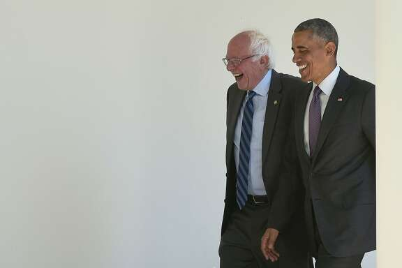 TOPSHOT - US President Barack Obama (R) walks with Democratic presidential candidate Bernie Sanders through the Colonnade for a meeting in the Oval Office on June 9, 2016 at the White House in Washington, DC. / AFP PHOTO / MANDEL NGANMANDEL NGAN/AFP/Getty Images