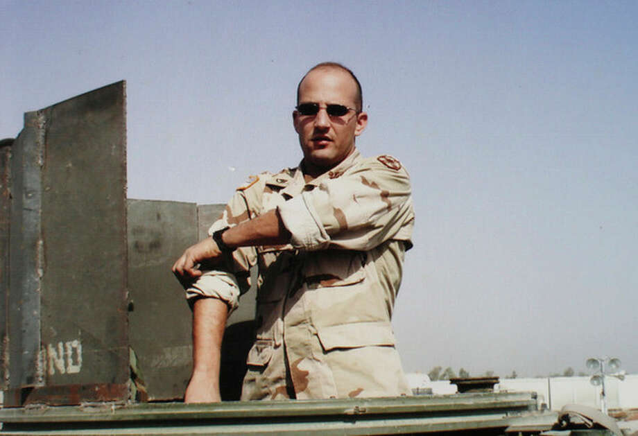 This photograph provided by the family on Saturday, Dec. 10, 2011 shows Deriek Crouse during his 2003-04 military tour in Iraq. Officer Deriek W. Crouse was making a traffic stop when police say Ross Truett Ashley, a 22-year-old student from a nearby college, walked up to his cruiser and shot him on the campus of Virginia Tech in Blacksburg, Va., Friday, Dec. 9, 2011.. (AP Photo/The Roanoke Times, Family Photo) Copy of a photograph of Deriek Crouse during his 2003-04 military tour in Iraq. Copy photograph made in Christiansburg December 10 2011. (AP Photo/The Roanoke Times) / Family Photo Via The Roanoke Times