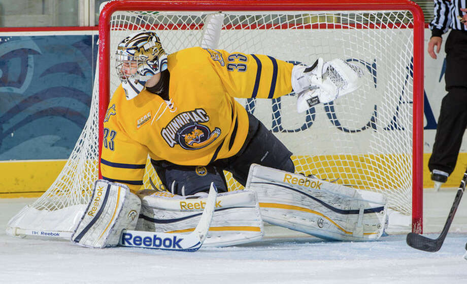 In this Dec. 7, 2012, photo provided by Quinnipiac University, Quinnipiac goalie Eric Hartzell guards the net in a game against Princeton in Hamden. Conn. The Bobcats are 18-3-3, unbeaten in their last 17 games and ranked second in the nation on Jan. 29. Hartzell leads the nation with a goals-against average of 1.46. (AP Photo/Quinnipiac University, John Hassett) / Quinnipiac University
