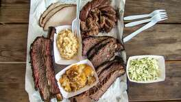 Lines form early at Nichole and Will Buckman's CorkScrew BBQ in Spring, where meat and sides often sell out early in the afternoon. Beef rib, turkey, sausage, pulled pork, brisket, mac-n-cheese, coleslaw, peach cobbler