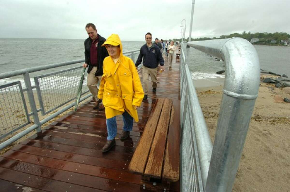 Photo/Alex von Kleydorff. People bundled up for the wind and rain take a walk along the new pier at Cummings Beach Park