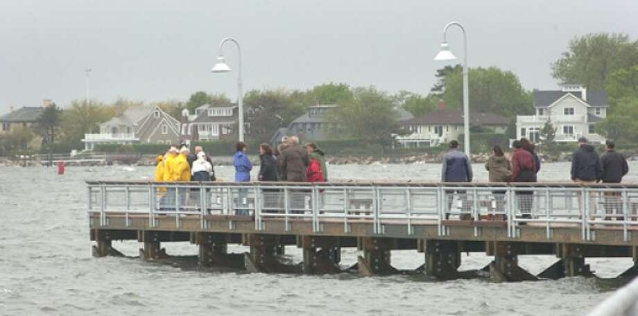 Photo/Alex von Kleydorff. People gather at the end of the new pier at Cummings Beach park.