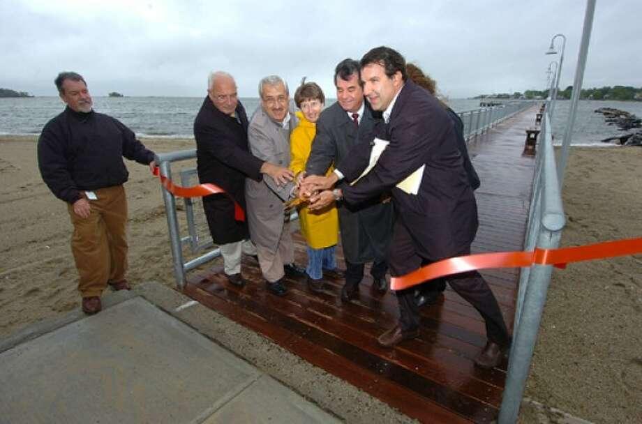 Photo/Alex von Kleydorff. Mayor Michael Pavia helps City Engineer Lou Casolo cut the ribbon on the Cummings Beach recreational pier