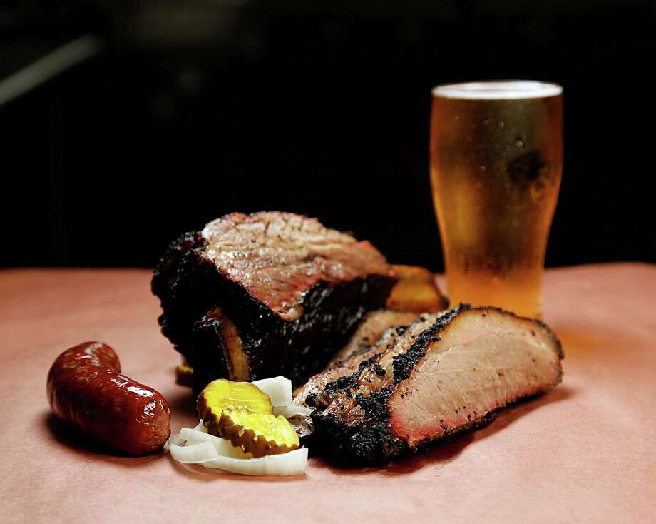 Beef rib, brisket, sausage and beer at Killen's in 2016 in Pearland. Photo: James Nielsen, Staff / © 2016  Houston Chronicle
