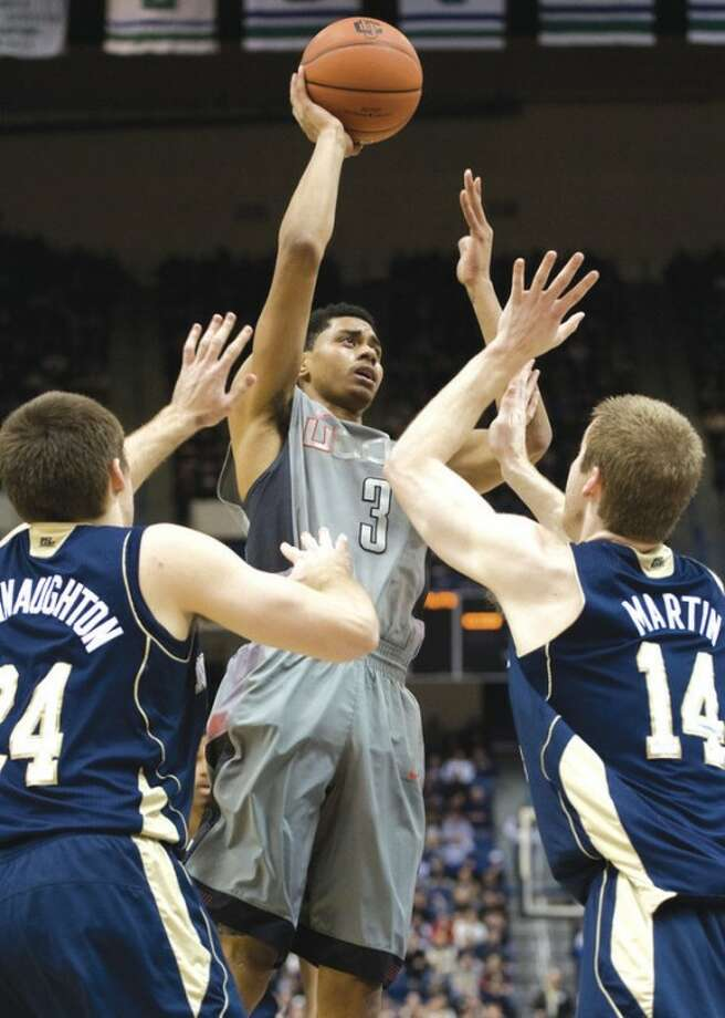 Connecticut's Jeremy Lamb (3) shoots over Notre Dame's Pat Connaughton, left, and Scott Martin (14) in the first half of an NCAA college basketball game in Hartford, Conn., Sunday, Jan. 29, 2012. (AP Photo/Jessica Hill)