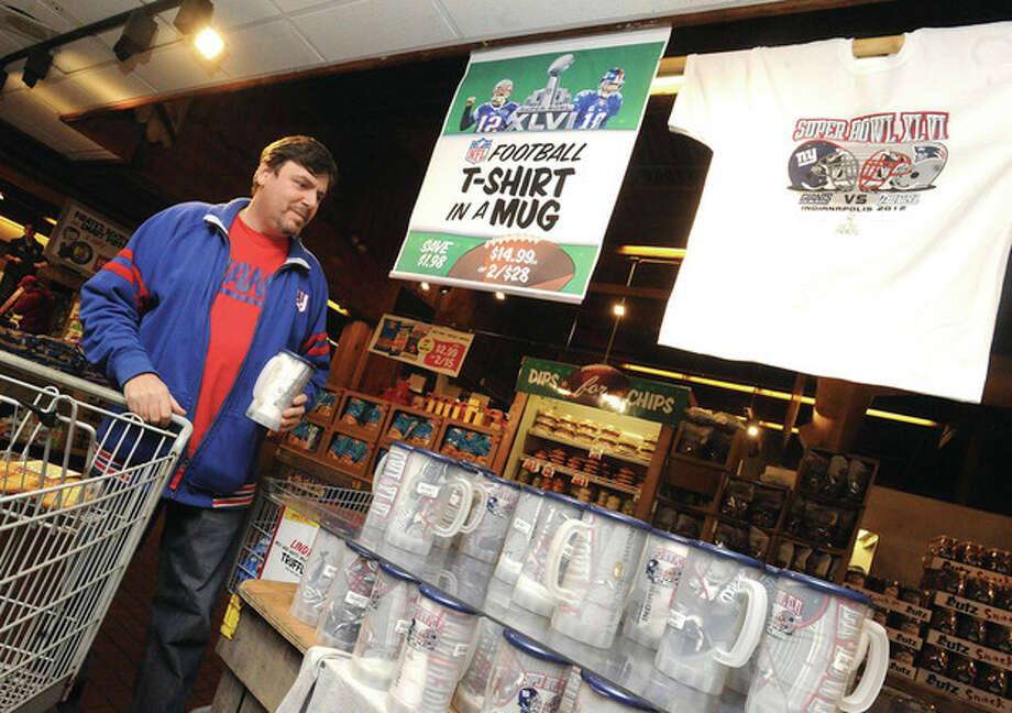 Hour photo / Matthew Vinci Giants fan Mark Shallin stops by one of the many promotional displays that Stew Leonard's has set up for the upcoming Super Bowl game. Below, coffee blends for Super Bowl fans.