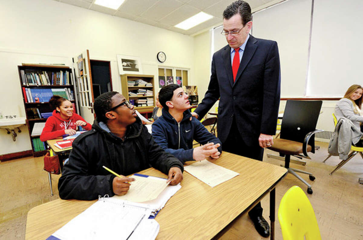 CT Governor Dannel Malloy talks with students Joey Ferraro and Kyle Lors durin his visit to Briggs High School in Norwalk Friday to discuss the 2012 education reform package, the Commissioner's Network, that aims to turnaround some of the lowest performing schools in the state in order to help thousands of students receive a quality education and close the achievement gap. Hour photo / Erik Trautmann