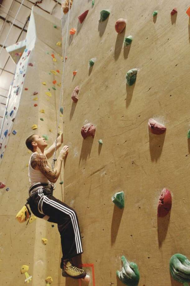 Hour photo / Erik Trautmann Jeff Stader climbs at Carabiner's Indoor Climbing at the Fairfield Sportsplex.