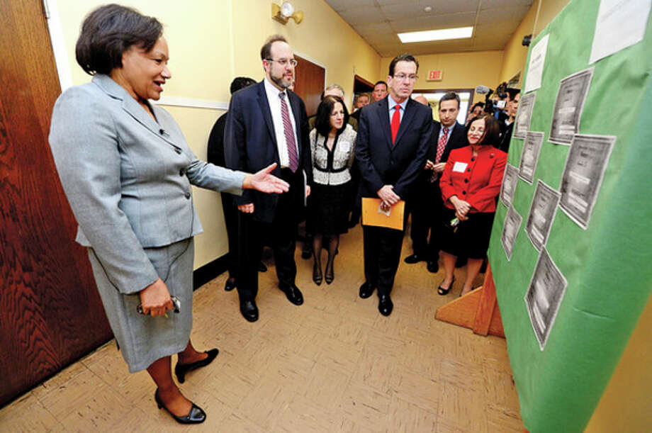 Briggs High School principal Dr Marie Allen leads a tour for CT Governor Dannel Malloy, right and CT Education Commissioner Stefan Pryor during a visit to discuss the 2012 education reform package, the Commissioner's Network, that aims to turnaround some of the lowest performing schools in the state in order to help thousands of students receive a quality education and close the achievement gap.Hour photo / Erik Trautmann / (C)2012, The Hour Newspapers, all rights reserved