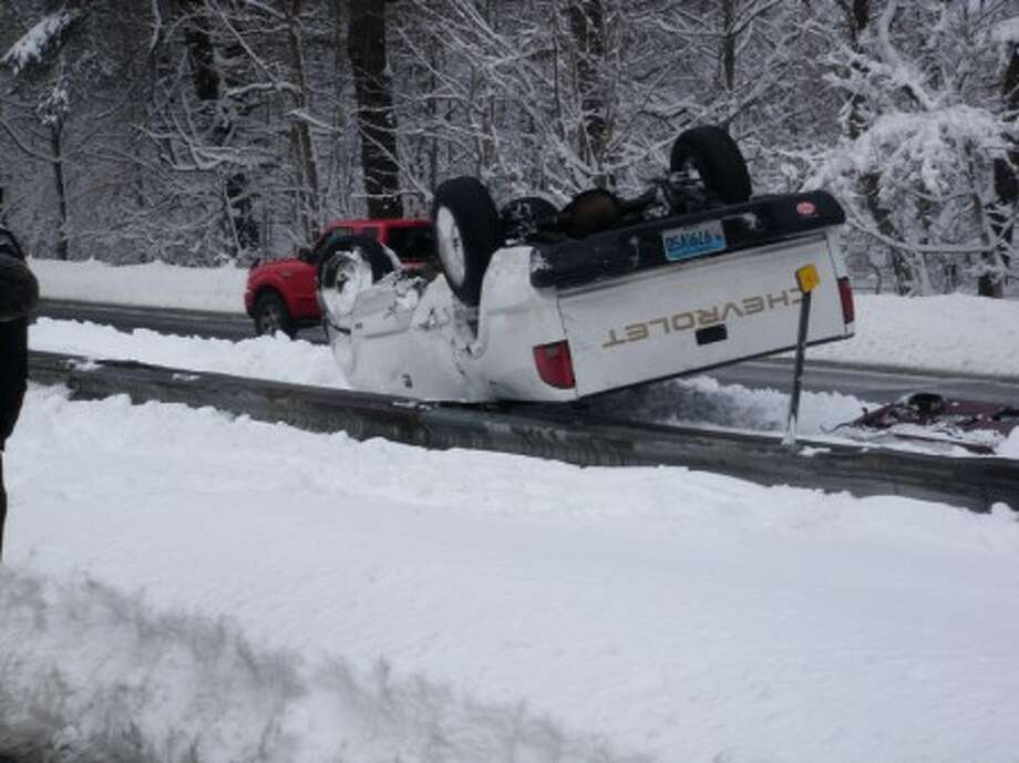 At 11:30 a.m. today, Westport Firefighters responded to a single vehicle rollover on the Merritt Parkway near Exit 42.