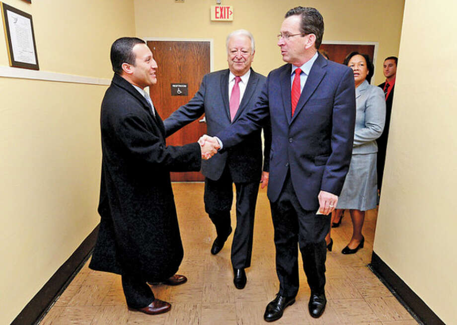 CT Governor Dannel Malloy is greetd by Norwalk Councilman Warren Pena and mayor Richard Moccia during a visit by the governor to Briggs High School in Norwalk Friday to discuss the 2012 education reform package, the Commissioner's Network, that aims to turnaround some of the lowest performing schools in the state in order to help thousands of students receive a quality education and close the achievement gap.Hour photo / Erik Trautmann / (C)2012, The Hour Newspapers, all rights reserved
