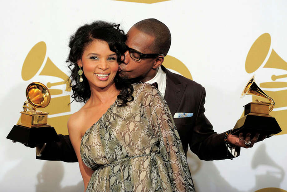 "Kirk Franklin, right, and Tammy Franklin pose backstage with the awards for best gospel album and best gospel song for ""Hello Fear"" at the 54th annual grammy Awards on Sunday, Feb. 12, 2012 in Los Angeles. (AP Photo/Mark J. Terrill) / AP"