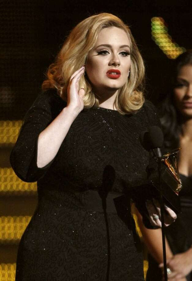 "Adele accepts the award for best pop solo performance for ""Someone Like You"" during the 54th annual Grammy Awards on Sunday, Feb. 12, 2012 in Los Angeles. (AP Photo/Matt Sayles)"
