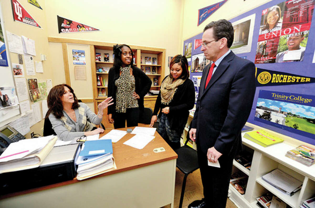 CT Governor Dannel Malloy talks with counselor Angela Tudisco and students Tanasia Ticking and Chantale Nelson during his visit to Briggs High School in Norwalk Friday to discuss 2012 education reform package, the Commissioner's Network, that aims to turnaround some of the lowest performing schools in the state in order to help thousands of students receive a quality education and close the achievement gap. Hour photo / Erik Trautmann