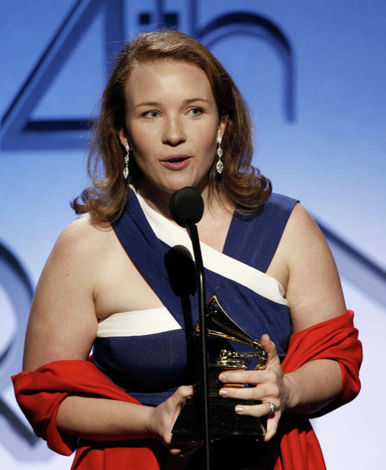 "Sasha Cooke accepts the award for best opera recording for ""Adams: Doctor Atomic"" at the 54th annual GRAMMY Awards pre-show on Sunday, Feb. 12, 2012 in Los Angeles. (AP Photo/Matt Sayles) / AP"
