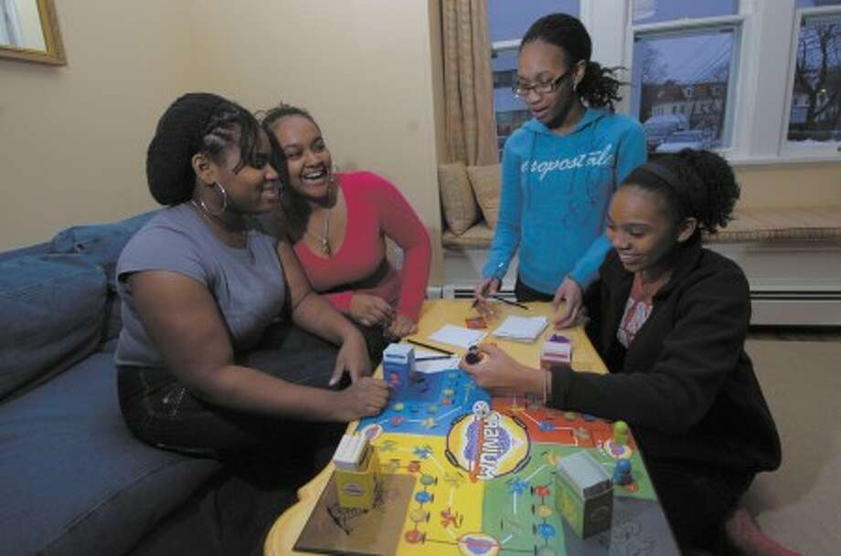 File photo/Alex von Kleydorff. A Better Chance kids play a game of Cranium , from left, Onessa Faulknor, Geena Pabarue, Amanda Allison. and Demaris Mozie.