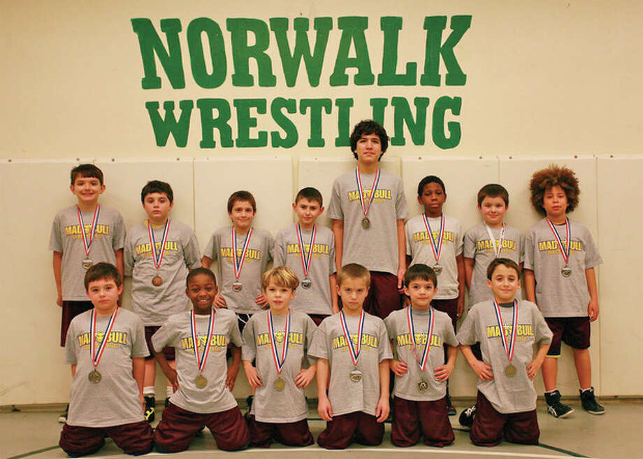 Contributed photo The Norwalk Mad Bulls youth wrestling team has garnered its fair share of medals over the past few weeks. Some of the medalists include, back row, from left to right, Conor Carrol, Jeffrey Cocchia, Sammy White, Peter Baez, Jeffrey Capone, Jakari Walker, Jake Bella, and Koy Price. Front row, Arthur Cocchia, Jaylen Carter, Jack Cahill, Michael Bartush, Luke Villaluz and Michael SantaLucia. Missing from the photo are Quint Bartush, Michael Berkowitz, Lester Harris, Nehemiah Harris, Issac Monti and Angel Nieves.