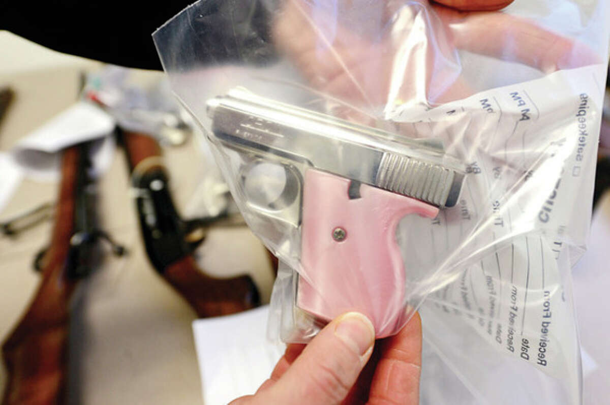 A Loran .25 calibar semi-automatic pistol received during the Norwalk Police Department's first ever Gun Buy Back program Saturday which offered gift cards for firearms in working condition. Hour photo / Erik Trautmann