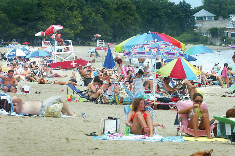 Hour photo / Alex von Kleydorff Crowds back Calf Pasture beach ona summer day in 2011. / 2010 The Hour Newspaper/Alex von Kleydorff