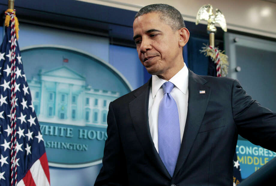 FILE - In this Dec. 8, 2011 file photo, President Barack Obama leaves a news conference in the White House briefing room in Washington. Leaving behind a year of bruising legislative battles, President Barack Obama enters his fourth year in office having calculated that he no longer needs Congress to promote his agenda, and could even benefit in his re-election campaign if lawmakers take little action in 2012. (AP Photo/Carolyn Kaster, File) / AP