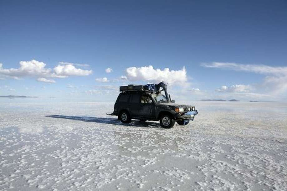 This March 5, 2010 photo courtesy of Nicolas Rapp shows Rapp''s truck at the Salar de Uyuni salt flat, in southwest Bolivia. Rapp has just returned from 15 months driving around the world in a Toyota Land Cruiser on a 37,000-mile trip to 33 countries. Rapp started the trip in November 2009, driving from New York to Buenos Aires, then South Africa to Iran, through India and Bangladesh and around southeast Asia before flying to the West Coast and driving home to New York. (AP Photo/Nicolas Rapp) NO SALES; EDITORIAL USE ONLY