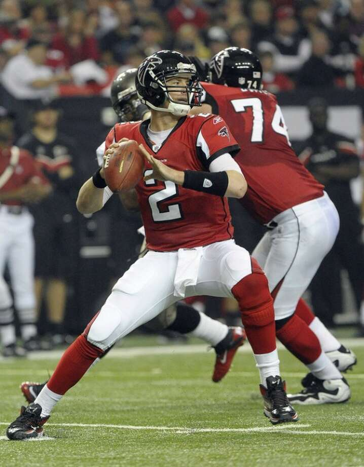 FILE - In this Jan. 1, 2012, file photo, Atlanta Falcons quarterback Matt Ryan (2) looks to pass against the Tampa Bay Buccaneers during the first half of an NFL football game in Atlanta. Ryan threw 10 TD passes and no interceptions in his last four regular-season games and will lead the Falcons in Sunday's wild-card playoff game against the New York Giants in East Rutherford, N.J. (AP Photo/John Amis, File)