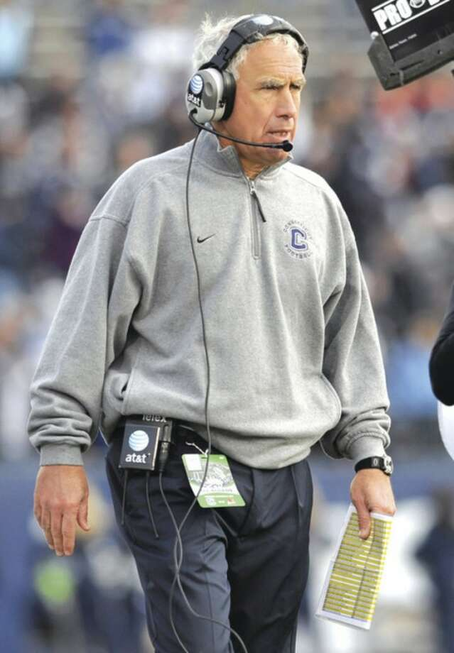 AP photo UConn head coach Paul Pasqualoni paces the sidelines during a recent game. The Huskies need a victory in Saturday's regular-season finale to become bowl eligible.
