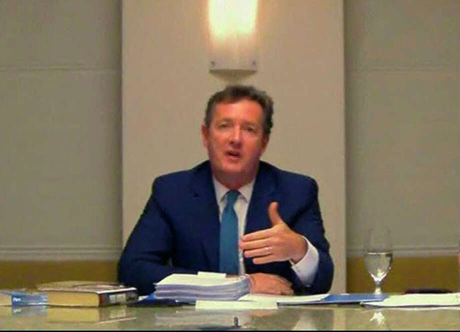 In this image made from video, CNN star interviewer Piers Morgan answers questions Tuesday, Dec. 20, 2011 from a media ethics inquiry sitting in London, England, about his time at the top of Britain's tabloid industry, at an unknown location in the U.S. Morgan ran two British tabloids - the News of the World and the Daily Mirror - before his editorship was cut short by scandal in 2004. (AP Photo, Pool) / POOL