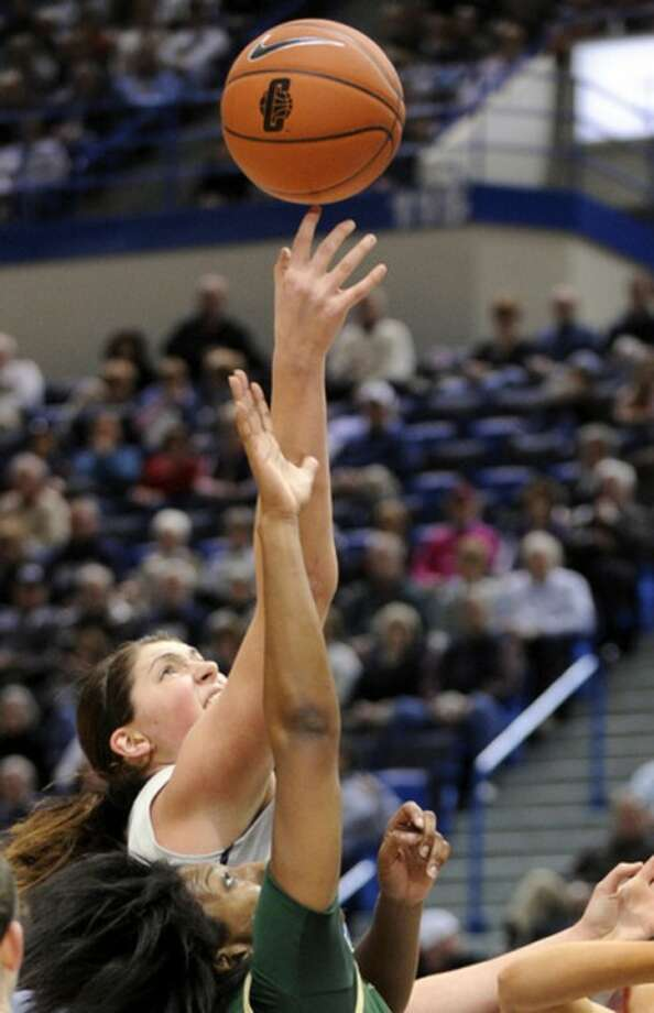 Connecticut's Stephanie Dolson, left, fights for a rebound with South Florida's Tiffany Conner during the first half of an NCAA college basketball game in Hartford, Conn., on Saturday, Jan. 28, 2012. (AP Photo/Fred Beckham)