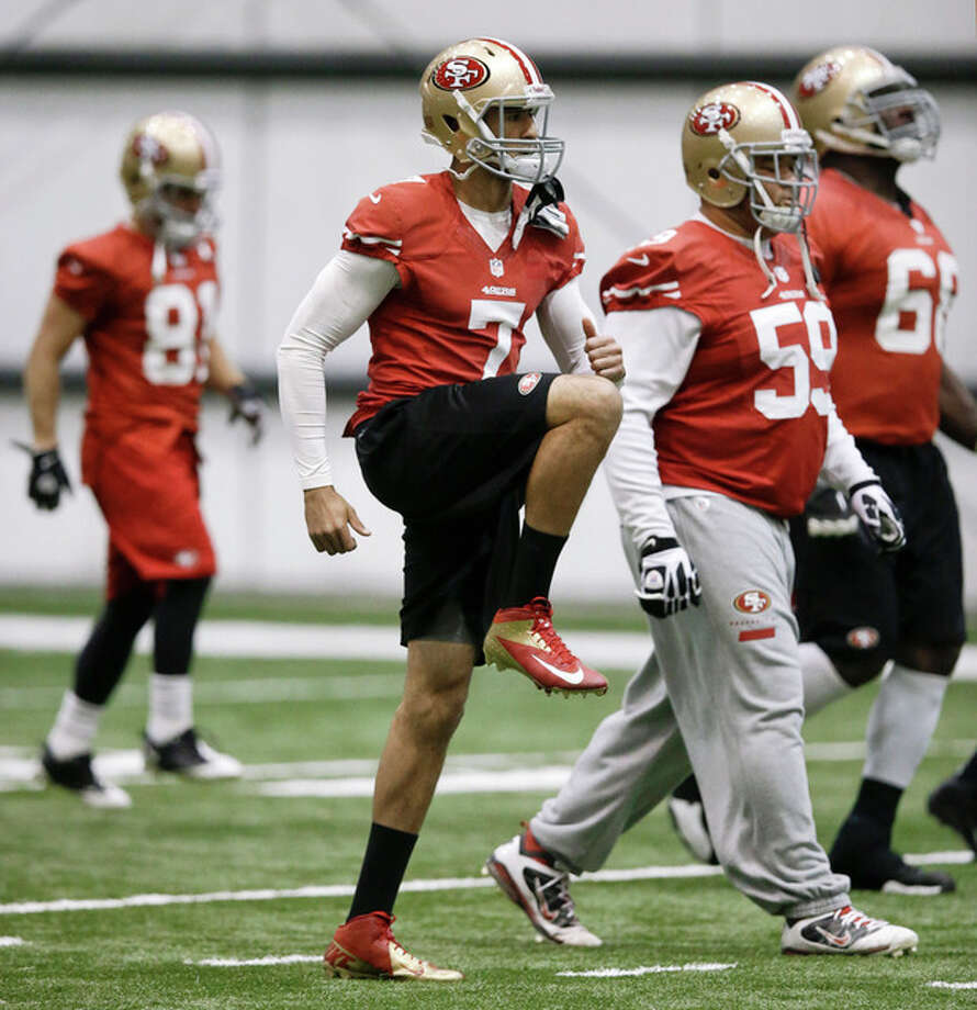 San Francisco 49ers quarterback Colin Kaepernick (7) stretches with teammates including center Jonathan Goodwin (59) during practice on Friday, Feb. 1, 2013, in New Orleans. The 49ers are scheduled to play the Baltimore Ravens in the NFL Super Bowl XLVII football game on Feb. 3. (AP Photo/Mark Humphrey) / AP