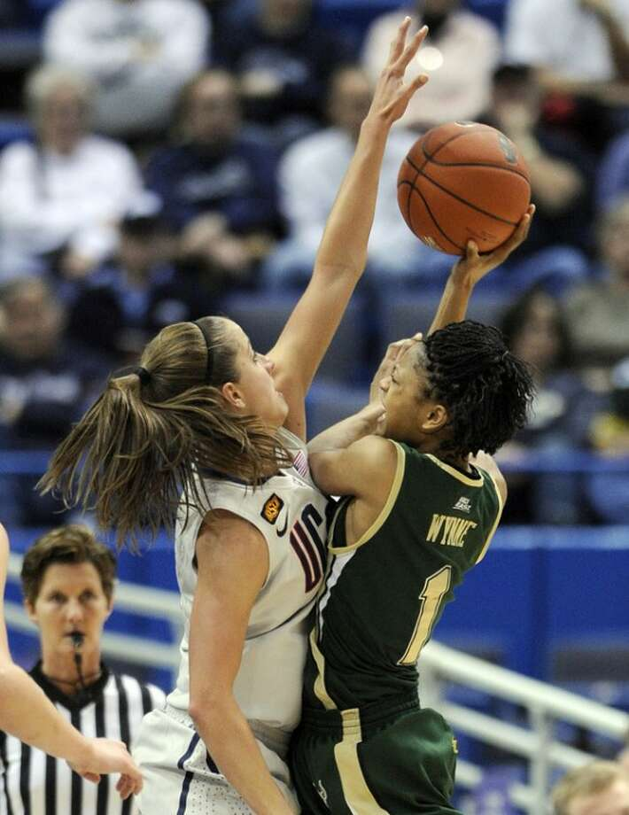 Connecticut's Caroline Doty, left, guards South Florida's Jasmine Wynne during the first half of an NCAA college basketball game in Hartford, Conn., on Saturday, Jan. 28, 2012. (AP Photo/Fred Beckham)