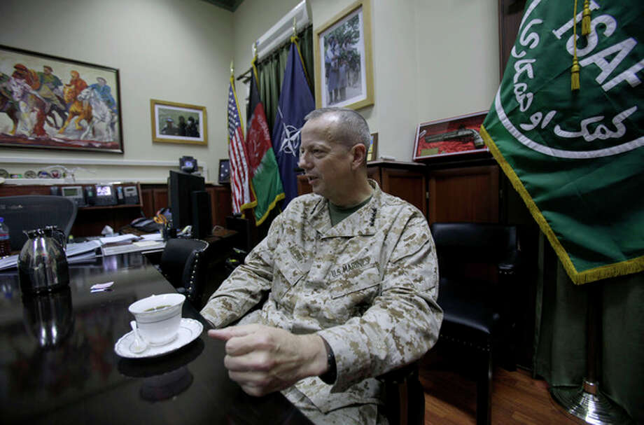 In this Wednesday, Oct. 19, 2011 photo, U.S. Marine Gen. John Allen, top NATO Commander in Afghanistan, gestures during an interview with The Associated Press in Kabul, Afghanistan. Anxious to accelerate peace moves, top-level U.S. officials have held talks with a representative of a major Afghan insurgent movement led by a former prime minister that Washington had branded as a terrorist. The meetings with the group led by Gulbuddin Hekmatyar show not only the degree of U.S. interest in pursuing a settlement but also the complexity of putting together an agreement acceptable to all sides in factious Afghanistan. (AP Photo/Muhammed Muheisen) / AP