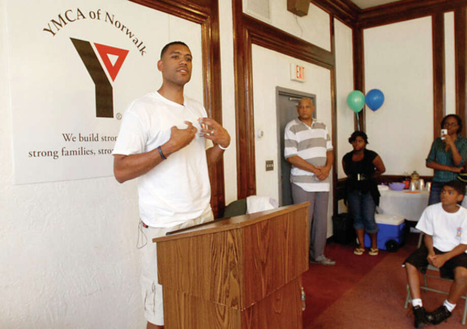 Former NY Knicks star and current Knicks executive Allan Houston announces the begining of the Father Child Mentor Program, also known as the F.I.S.L.L. (Faith, Integrity, Sacrifice, Leadership, Legacy) at the Norwalk Y saturday. The Father Child Mentor Program is a seven-week series of two-hour sessions designed to provide fun and relationship-building opportunities for fathers or father-figures and their middle-school age boys and girls. / (C)2011, The Hour Newspapers, all rights reserved