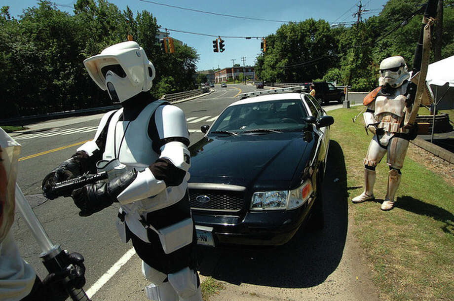 Hour Photo/Alex von Kleydorff Star Wars ÒStorm Troopers look for passing motorists and try to wave them into Ash Creek Saloon for the Tip A Cop fundraiser for Connecticut Special Olympics / 2011 The Hour Newspapers