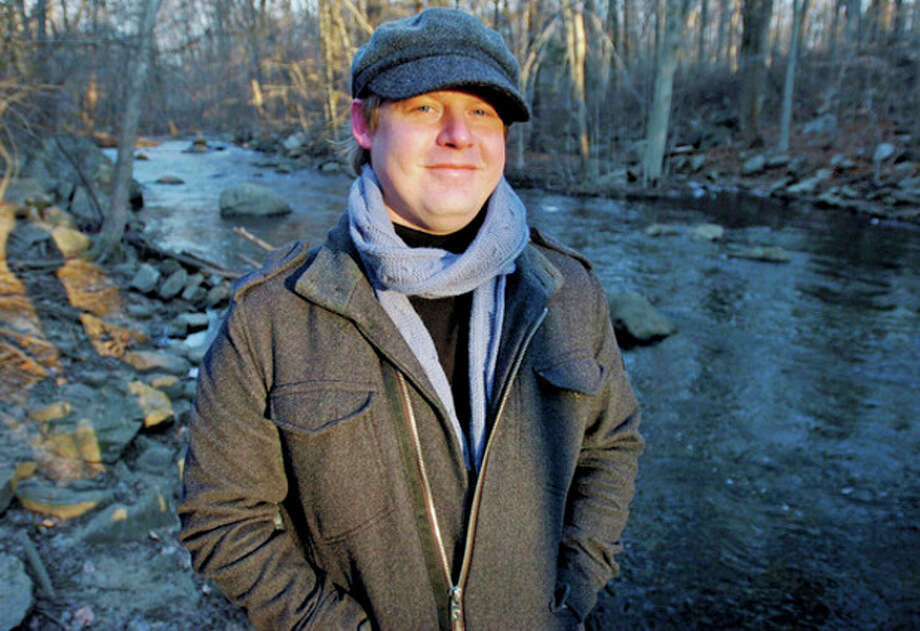 "Photo by Erik Trautmann Edward Donnelly, an English teacher at AITE in Stamford, at Mianus River Park, where he drew much of his inspiration for his first book of poetry, ""Eddy's Life Poetry."" / (C)2011, The Hour Newspapers, all rights reserved"