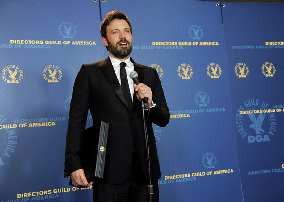 "Ben Affleck speaks holding his award for outstanding directorial achievement in feature film for ""Argo"" at the 65th Annual Directors Guild of America Awards at the Ray Dolby Ballroom on Saturday, Feb. 2, 2013, in Los Angeles. (Photo by Chris Pizzello/Invision/AP) / Invision"