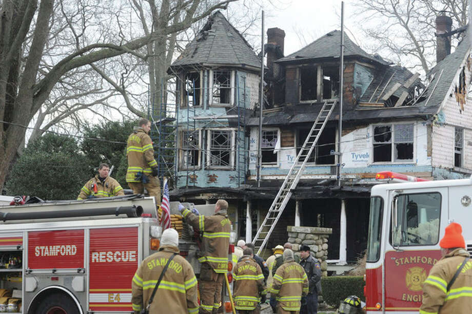 Stamford fire and rescue outside of a home at 2267 Shippan Avenue in Stamford. The fire broke out at 5:00 am Christmas morning, 5 are reported to have died in the blaze. hour photo/Matthew Vinci / (C)2011, The Hour Newspapers, all rights reserved