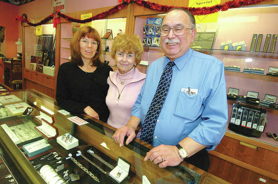 Hour Photo/ Alex von Kleydorff Wendy Kores Dileo, Dottie Dileo and Richard Dileo in their jewelry store on Belden Avenue Monday. After 33 years in business, Richard Dileo Jewelers will close for good in January. / 2011 The Hour Newspapers