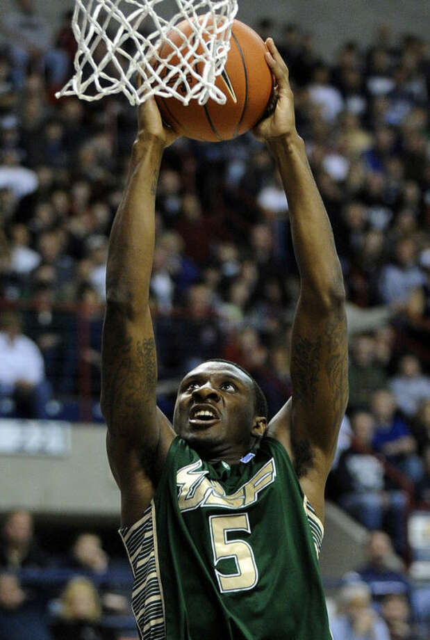 South Florida's Jawanza Poland scores during the first half of an NCAA college basketball game against Connecticut in Storrs, Conn., Sunday, Feb. 3, 2013. (AP Photo/Fred Beckham)